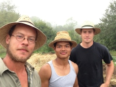 Farm crew in company hats